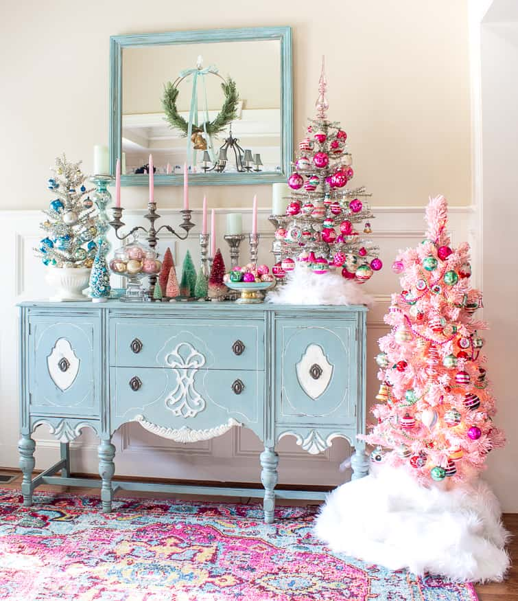 tinsel Christmas trees decorated with vintage Shiny Brite ornaments on a duck egg blue painted buffet