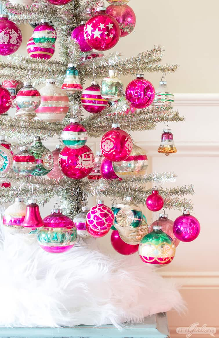 silver tinsel tree decorated with pink and green Shiny Brite ornaments
