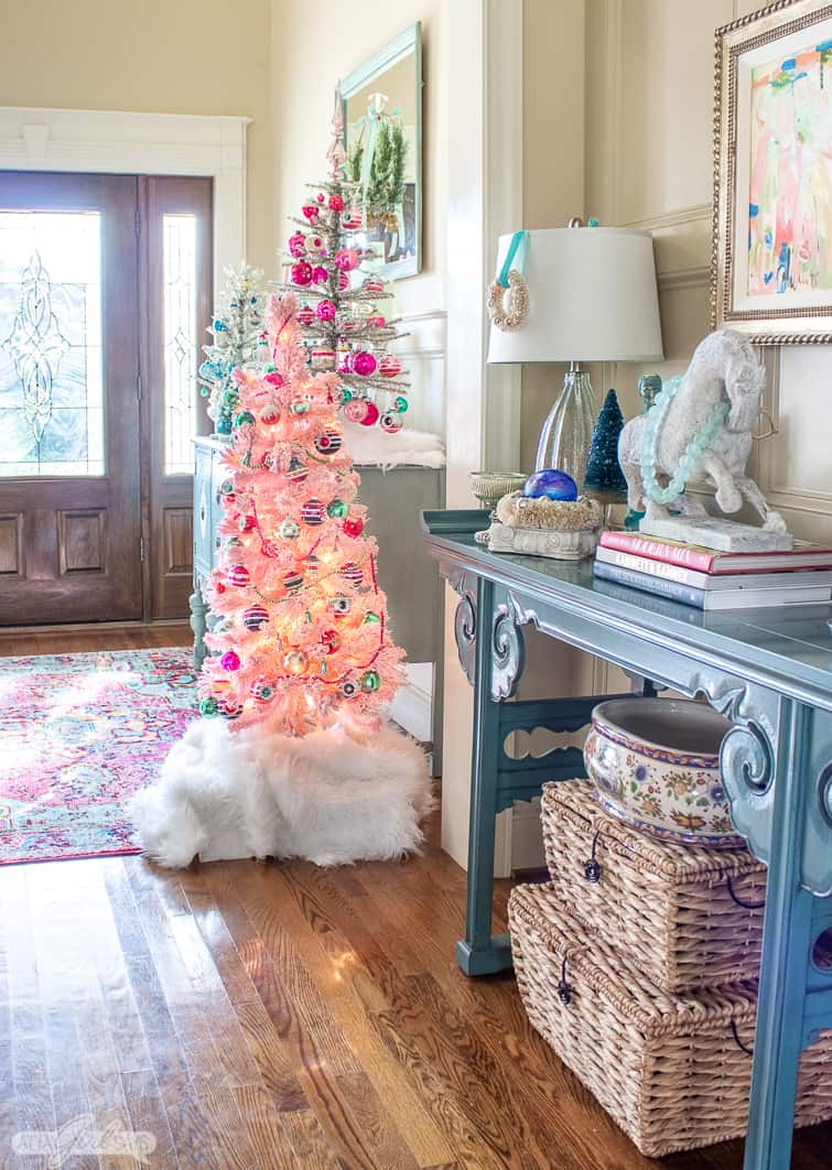 interior scene of Christms decor with a pink tree decorated with Shiny Brite ornaments