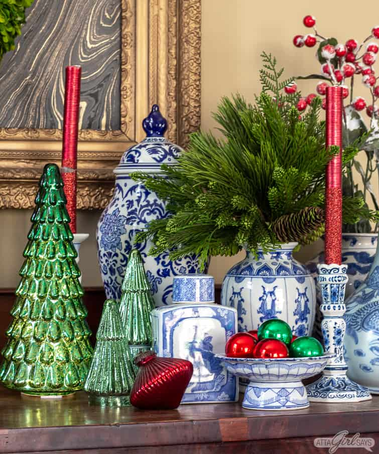 green mercury glass Christmas trees and blue and white pottery in a Christmas display