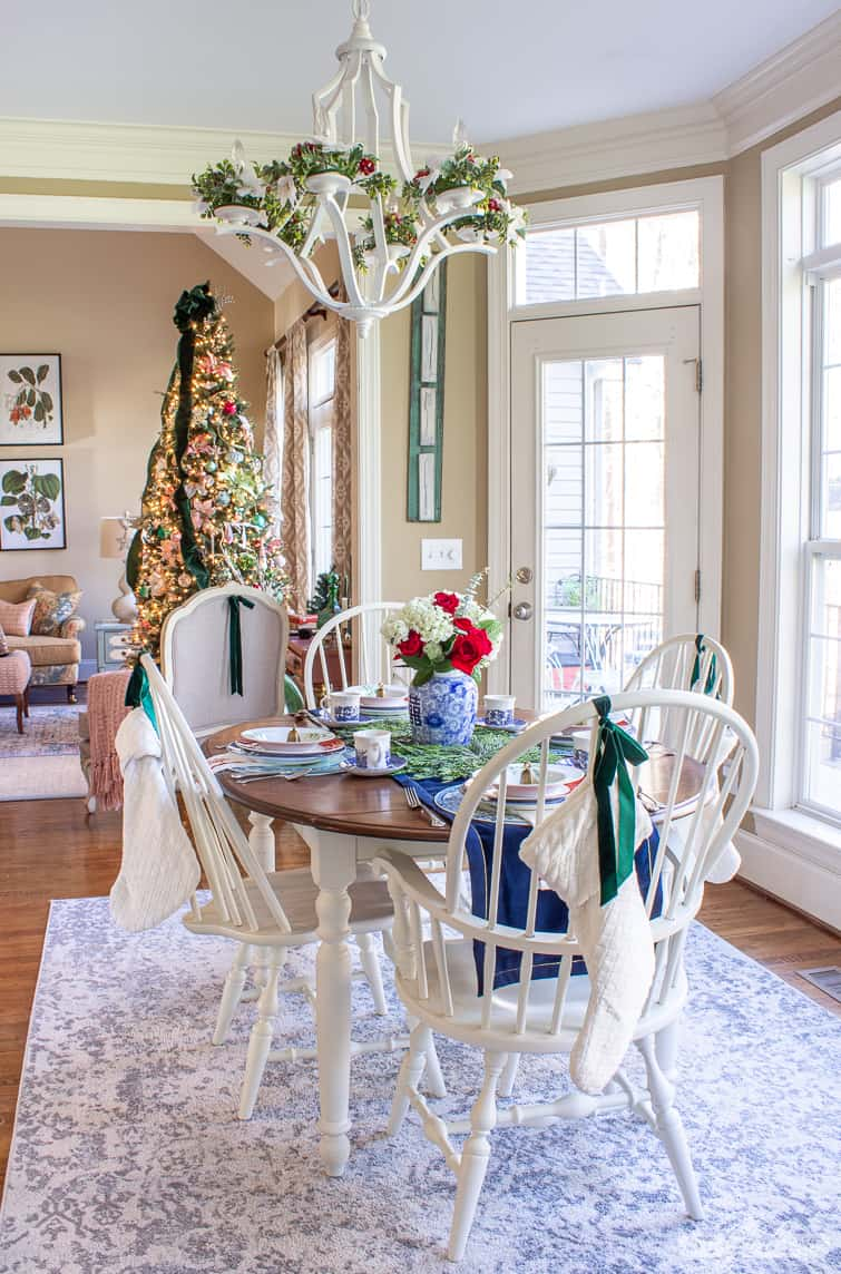 kitchen table decorated for Christmas overlooking an elegant Christmas tree
