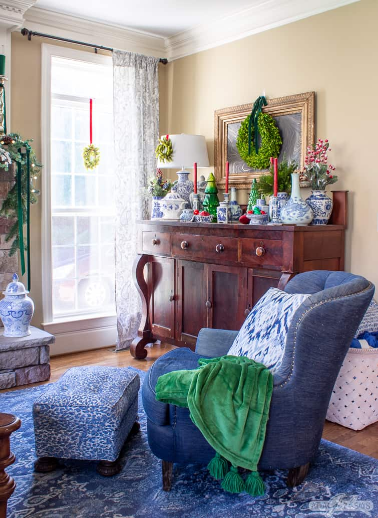 empire style buffet in a family room decorated with blue and white pottery for Christmas