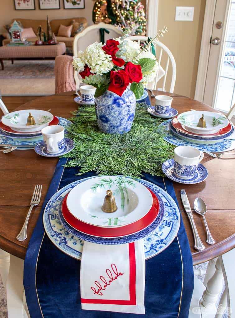 kitchen table decorated for Christmas with blue, white and green china