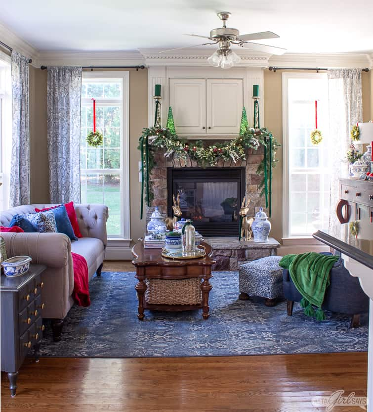 cozy family room with a stone fireplace decorated for Christmas