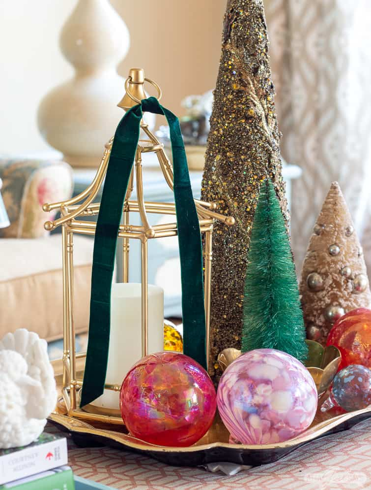 blown glass ornaments and assorted bottlebrush trees on a tray