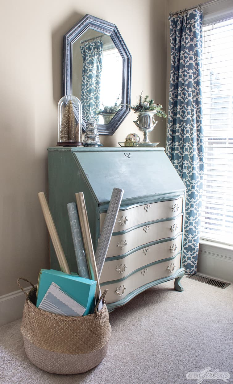 painted secretary desk decorated for Christmas in a bedroom