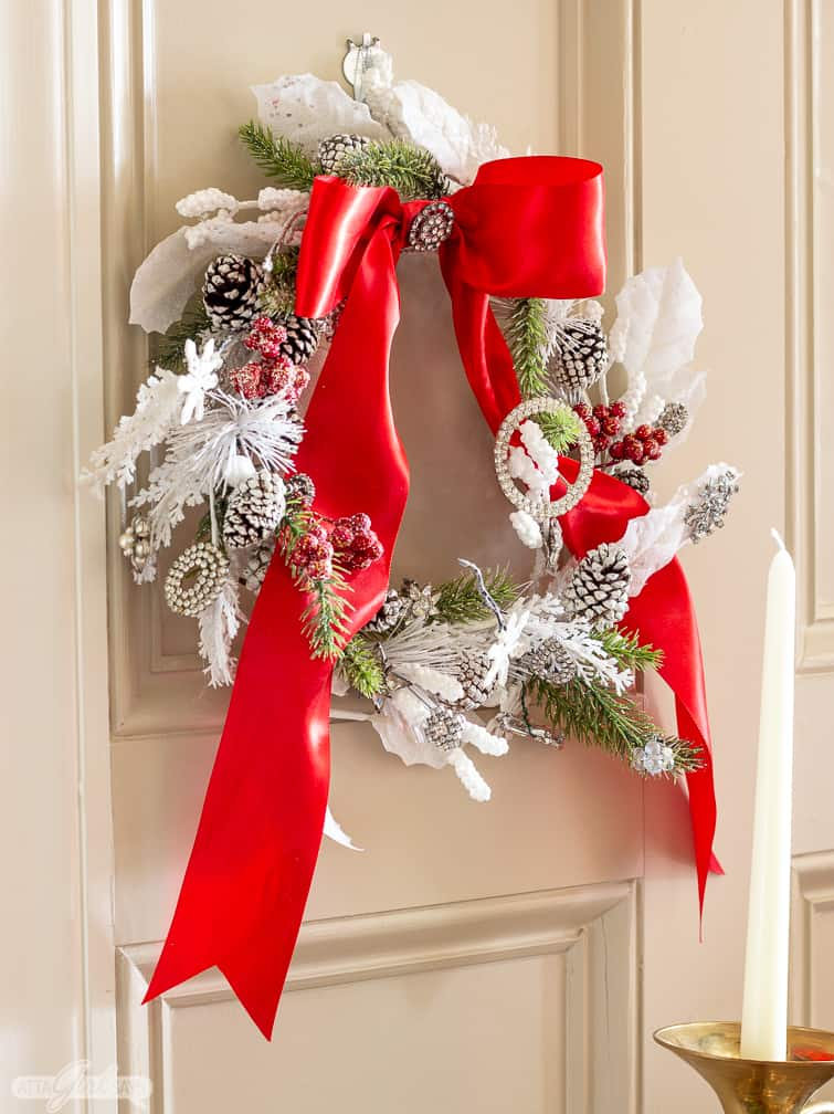 jeweled Christmas wreath on a paneled wall