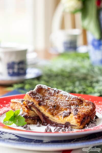 Plate of chocolate stuffed French toast on a Christmas table