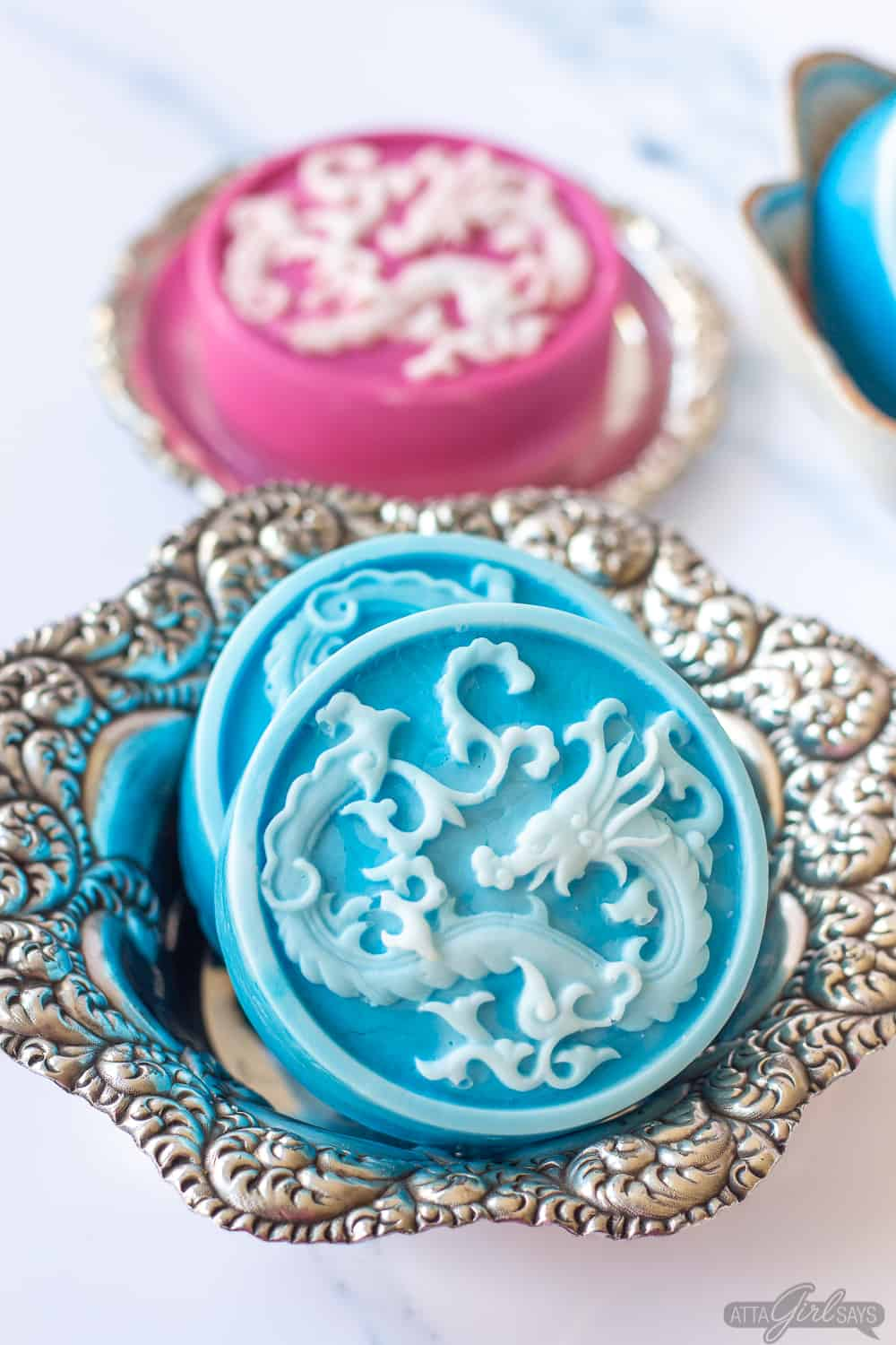 blue and white and pink and white decorative soaps with dragon motif