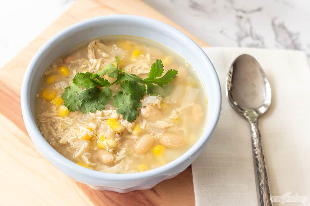 bowl of chicken and white bean chili with a spoon