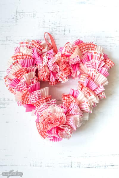 heart shaped Valentine's Day wreath using cupcake wrappers