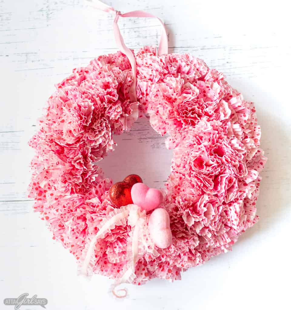 round Valentine's Day wreath made using cupcake liners