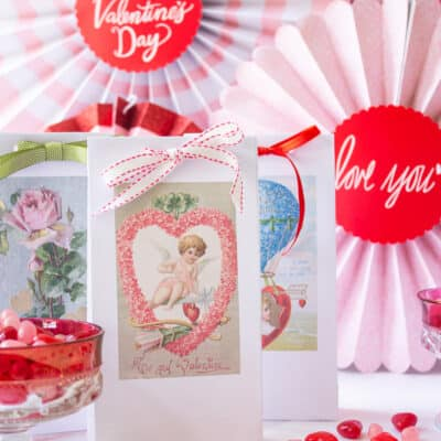 Valentine's Day party set up wtih goodie bags beside candy dishes
