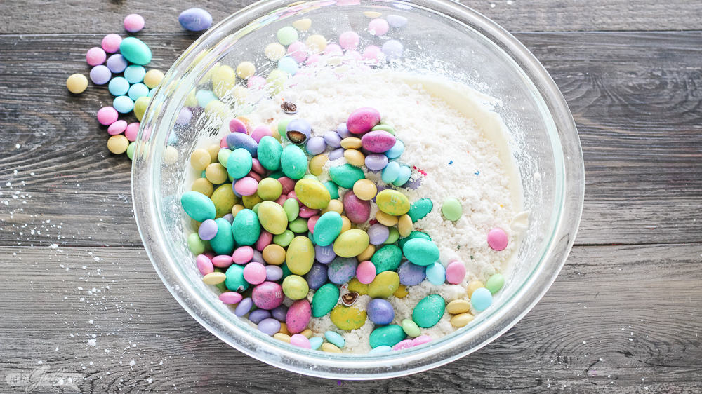 pastel M&Ms and Easter candy in a bowl of cake batter