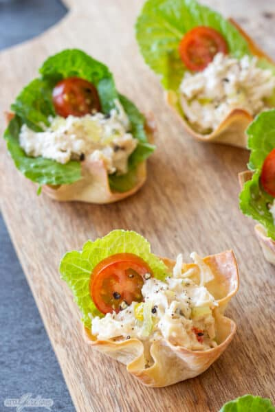 baked wonton cups filled with lettuce, tomato and chicken salad