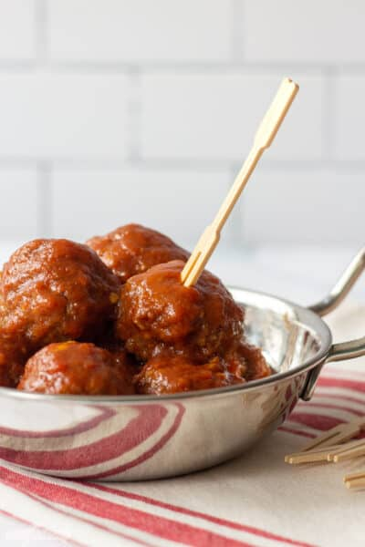 BBQ meatballs with sauce in a metal bowl
