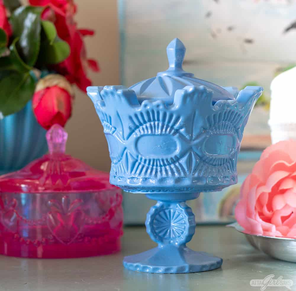 french blue crown milk glass resin trinket box with a pink resin jewelry box in background