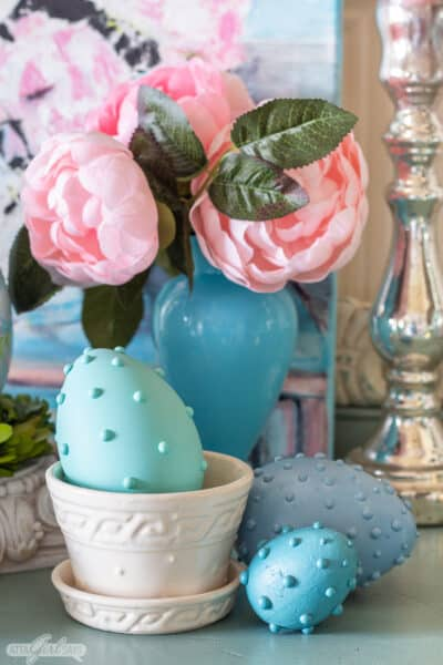 hobnail Easter eggs with blue opaline vase and McCoy pottery flower pot