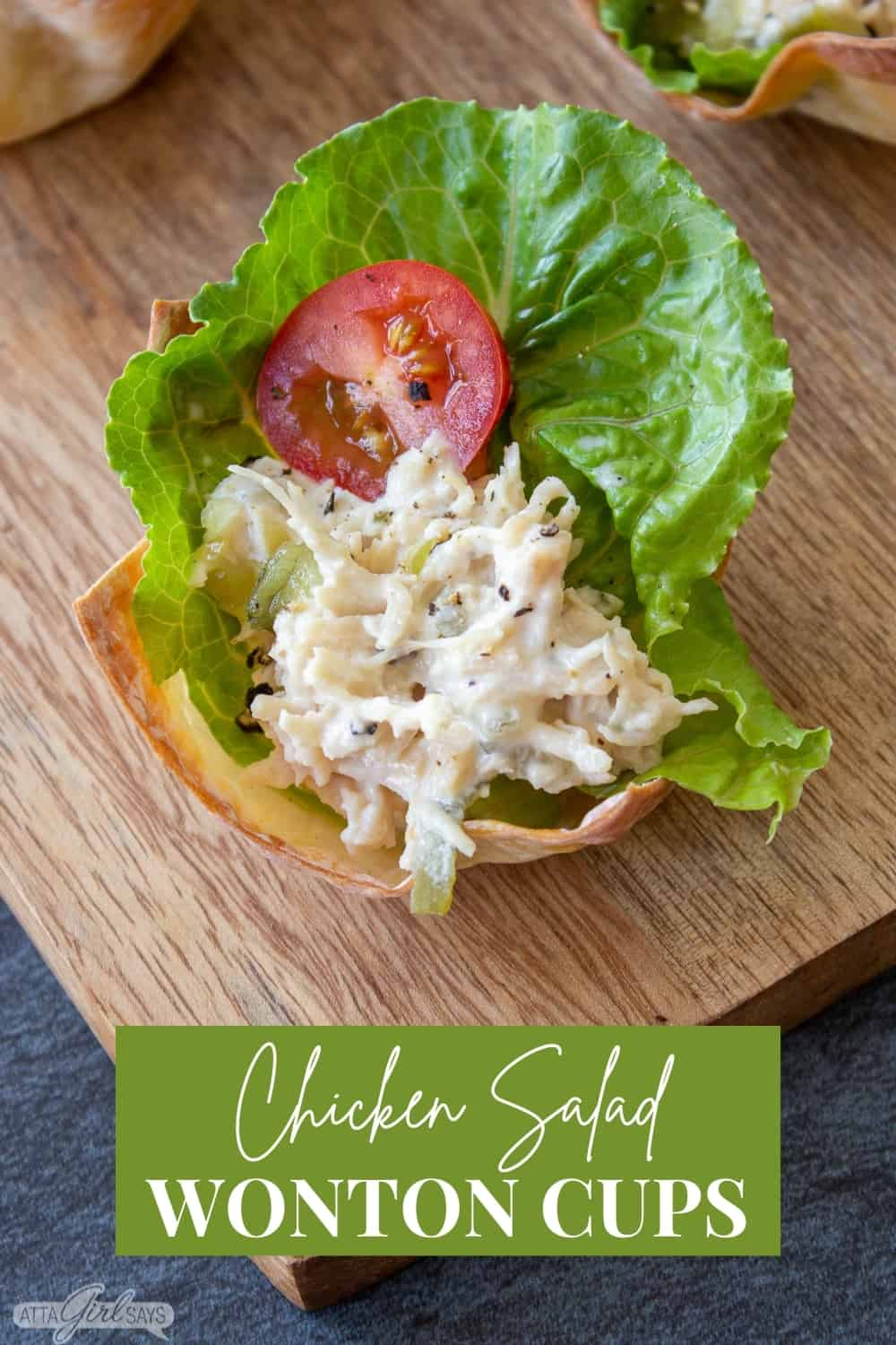 chicken salad, lettuce and a tomato slice in a baked wonton cup