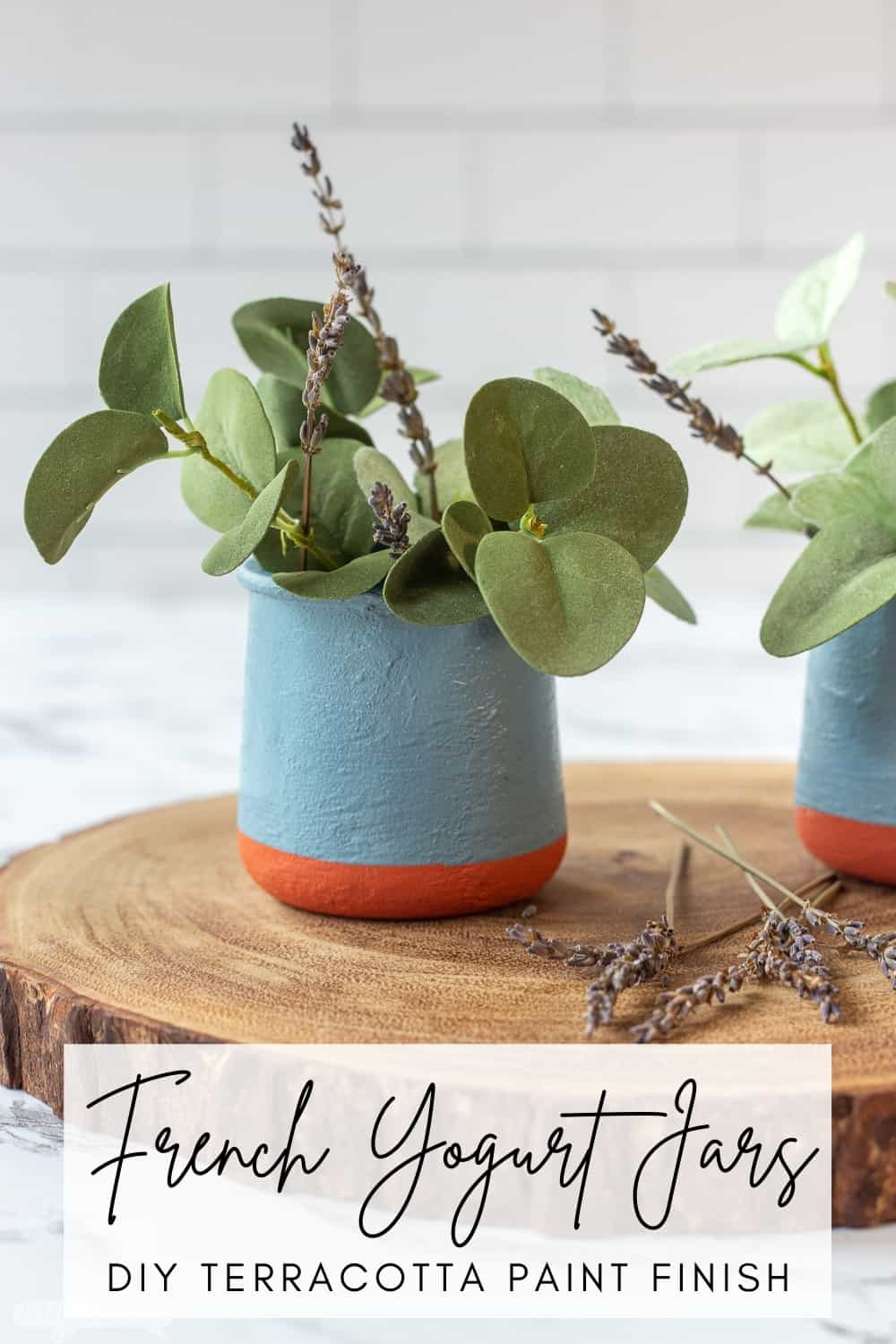 DIY painted French yogurt jar with greenery on a wooden charger