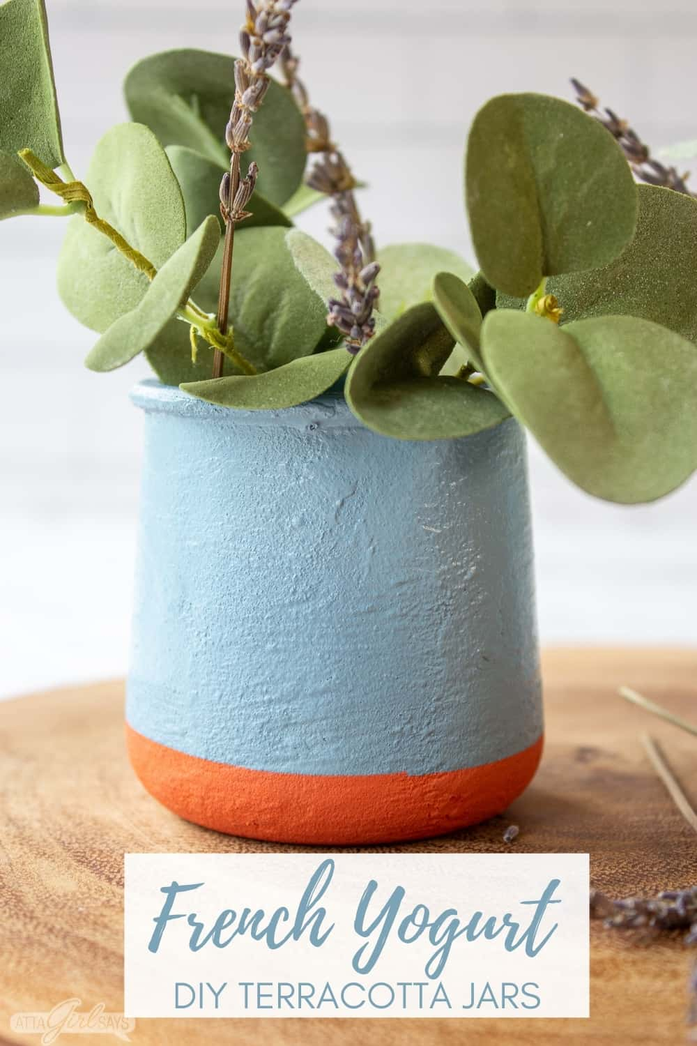 DIY La Fermiere French yogurt jar filled with eucalpytus and lavender on a wooden charger