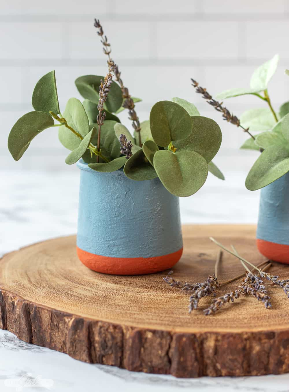 DIY painted replica La Fermiere yogurt pots with greenery on a wooden charger