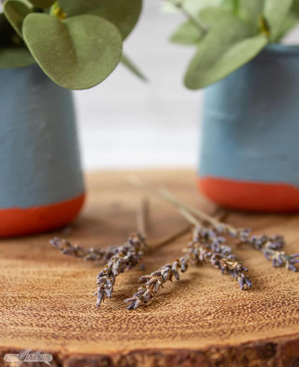 closeup photo of dried lavender stems with replica French La Fermiere yogurt pots in the background
