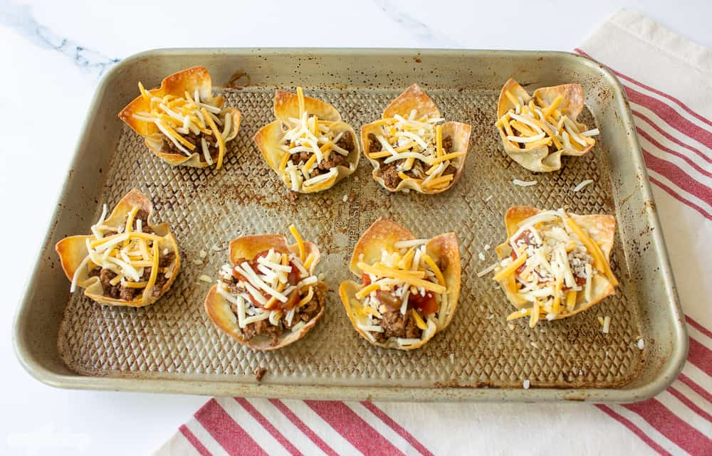 baking pan with wonton cups filled with taco filling