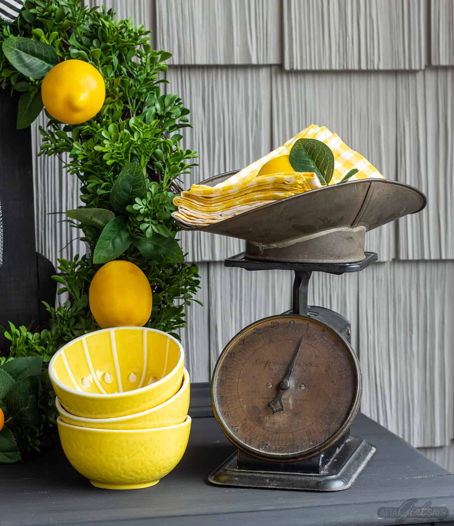 vintage scale with yellow gingham napkins on a buffet server