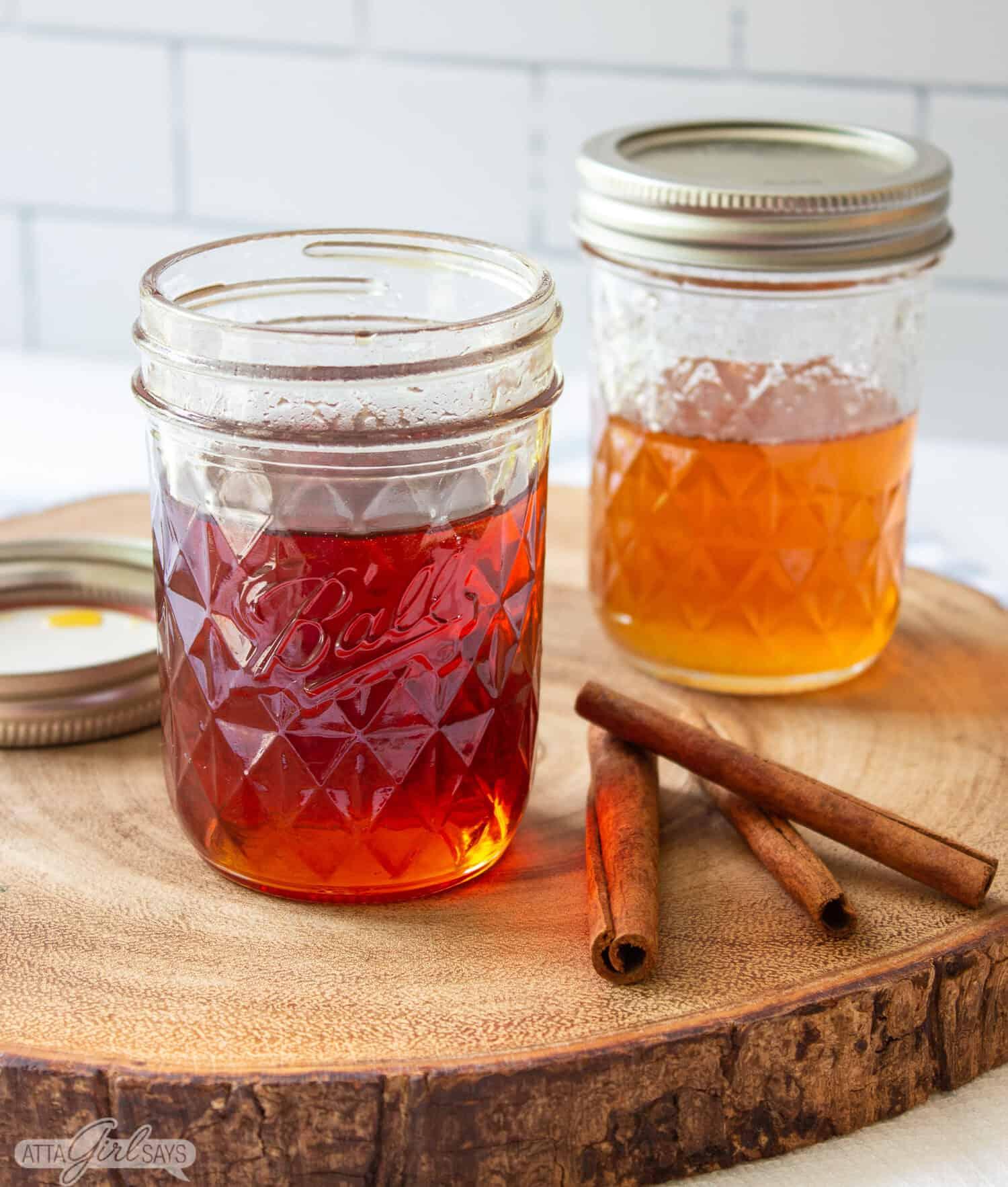 two jars of homemade cinnamon caramel simple syrup