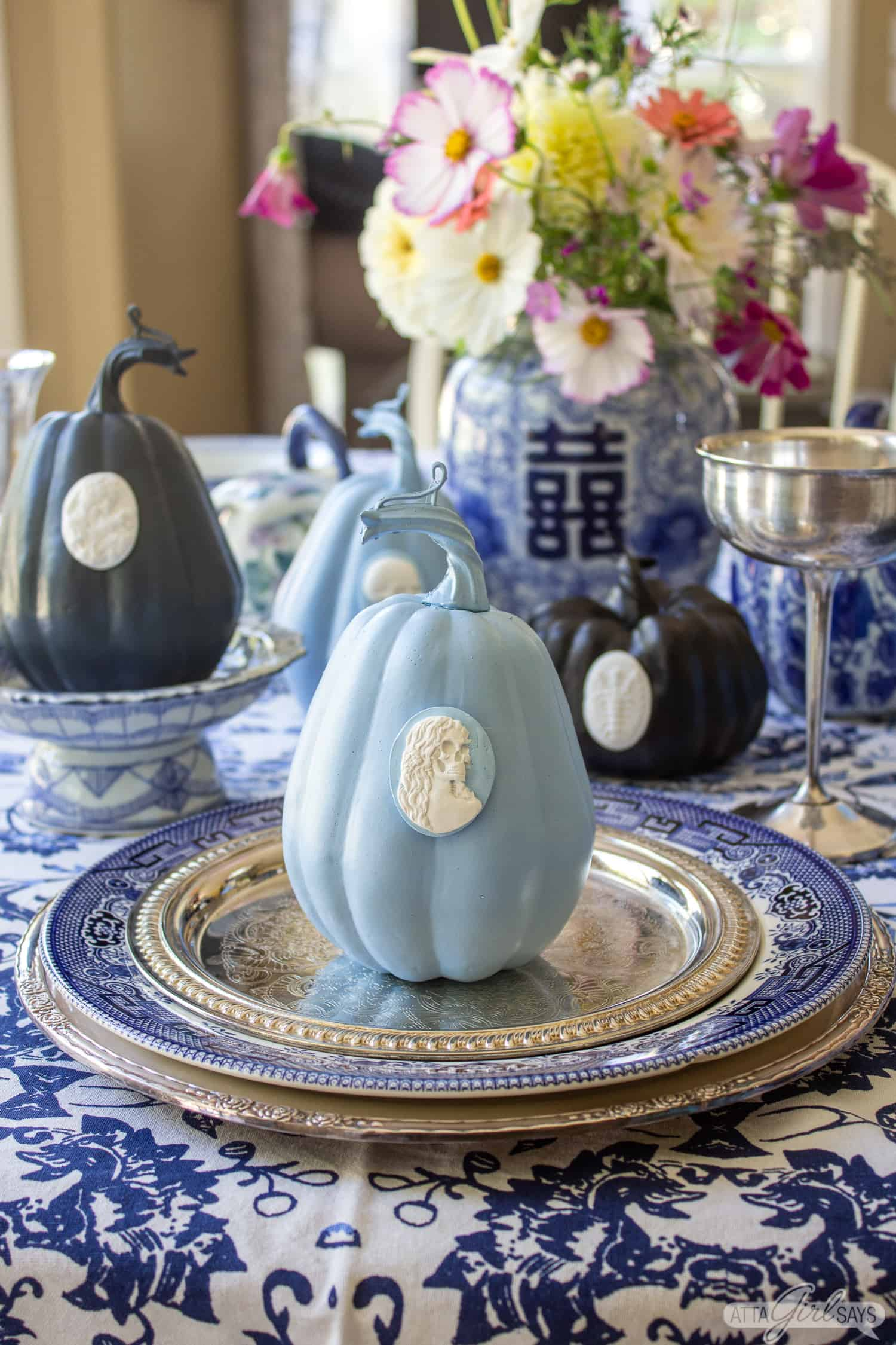 blue and white intaglio pumpkin in the style of Wedgwood jasperware in a formal tablesetting