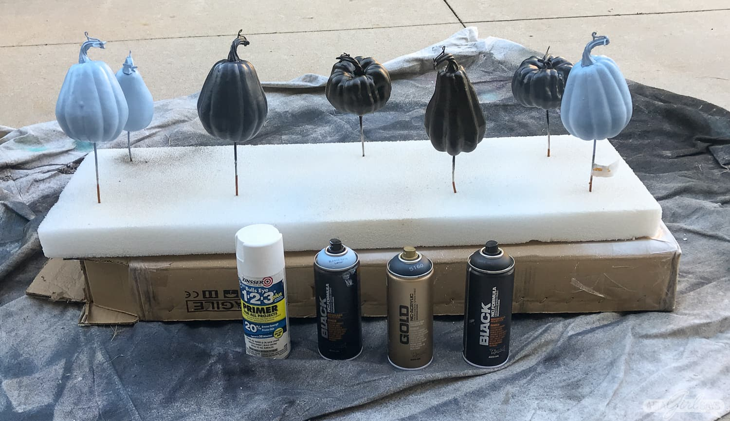 blue, black and navy spray painted pumpkins and gourds