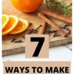 oranges, cinnamon sticks, spices and rosemary on a cutting board with a text overlay