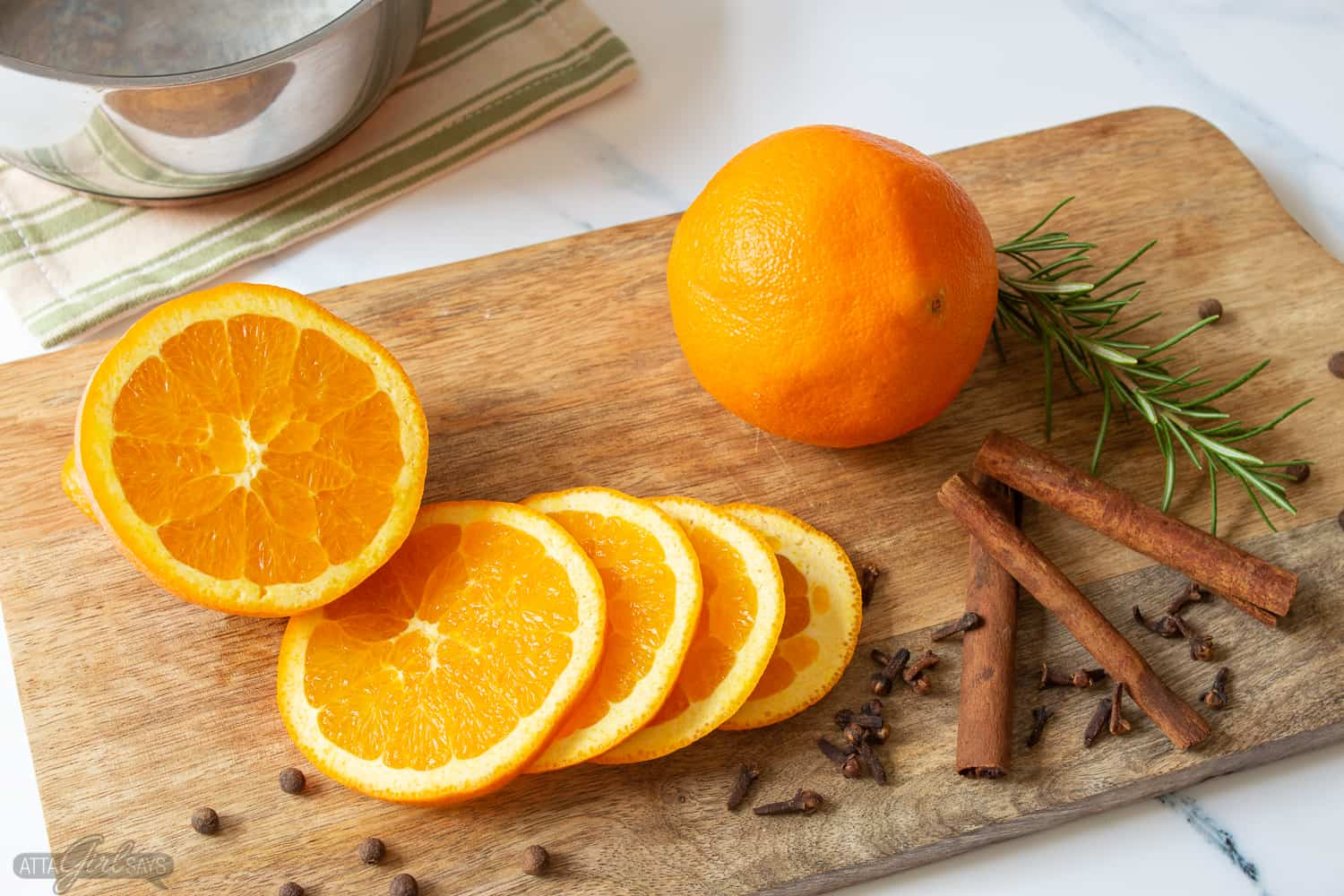 sliced oranges, cinnamon sticks, spices and herbs for stovetop potpourri