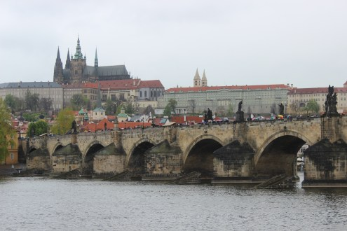 Charles Bridge and St. Vitus cathedral on the background