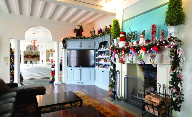 ALTA VISTA: The family room features the winter village, a Santa Claus collection, festive decorations on the mantle, along with the family's stockings waiting for Santa's arrival.