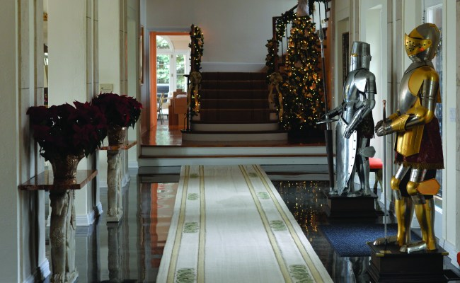 ALTA VISTA: Knights, which are reproductions of actual armor from Toledo, Spain, flank the front door in the grand hallway during the holidays.