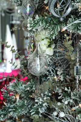 GLANWORTH GARDENS: The dining room tree is flocked to look like freshly fallen snow and decorated with white hydrangeas, eucalyptus boughs accented with silver glitter, and a combination of glistening silver and crystal ornaments.