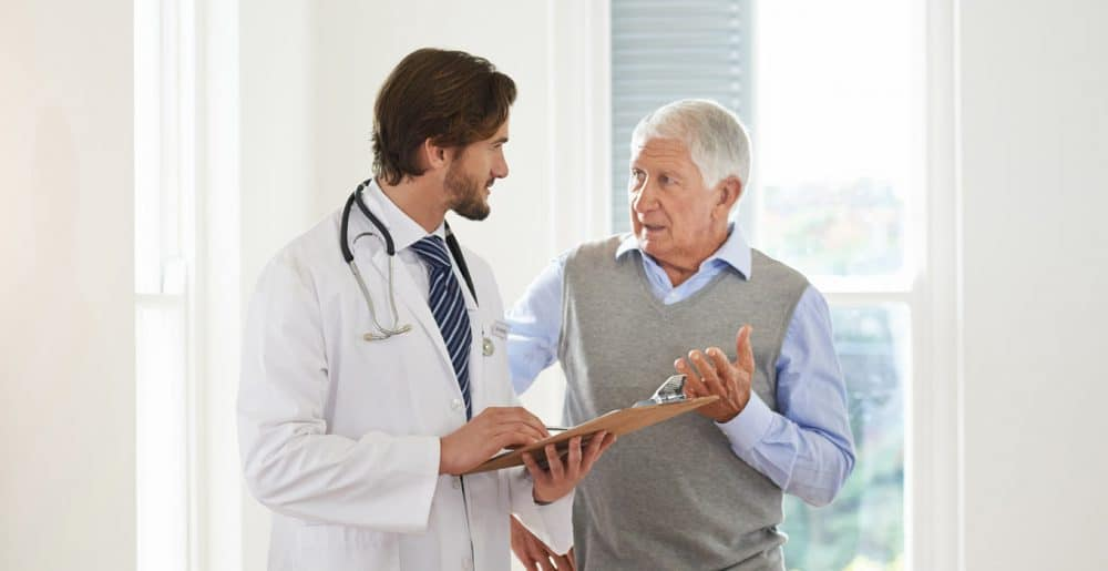 Doctor helping an elderly patient