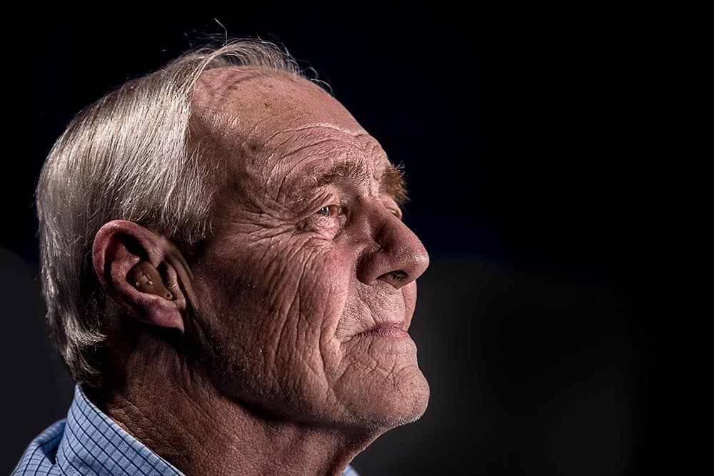 man with hearing aid image