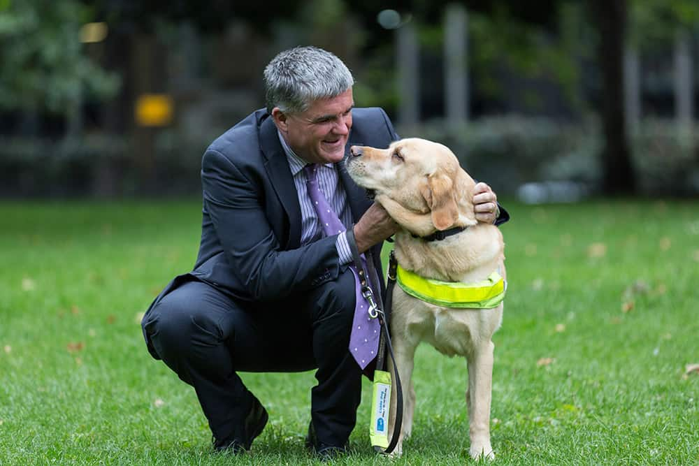 Neil Heslop OBE with his guide dog Storm image