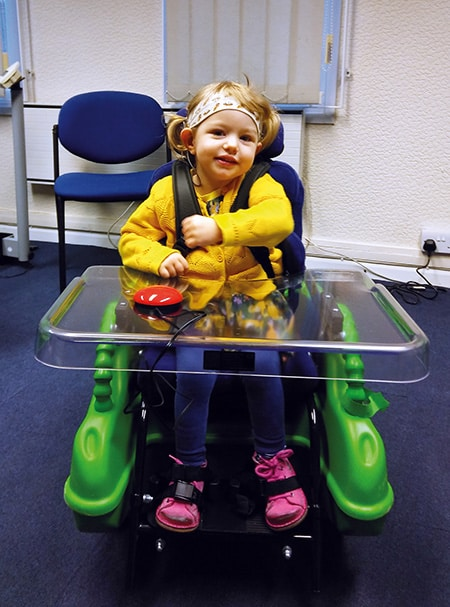 Olive with her Bugzi powerchair image