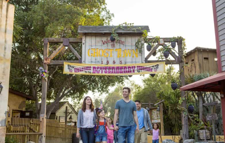 boysenberry-festival-family-in-front-of-ghost-town-sign-2