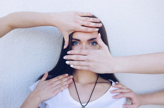 girl with hands covering her face becomes self-aware