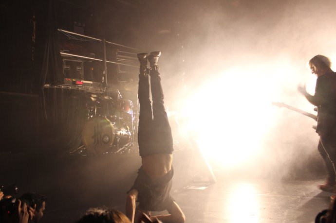 New Politics' David Boyd performed a crowd-pumping acrobatics display mid-song.