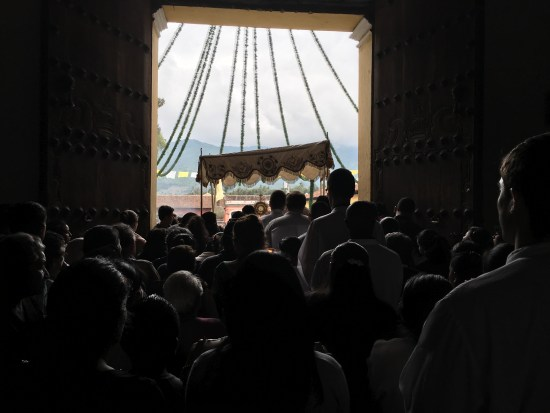 The Eucharistic Procession leaving the Church through the main doors.