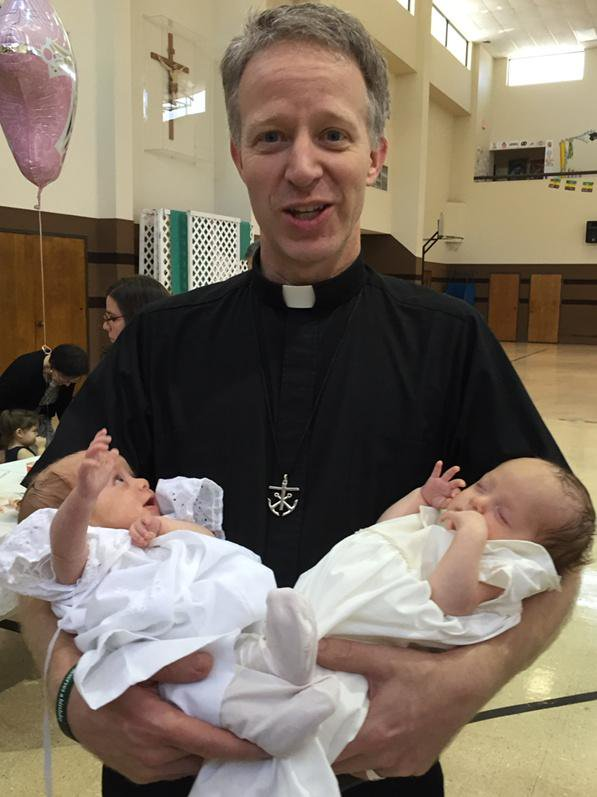 Bishop-Elect Bill Wack holding Ana & Dorothy Kraft after their baptism.