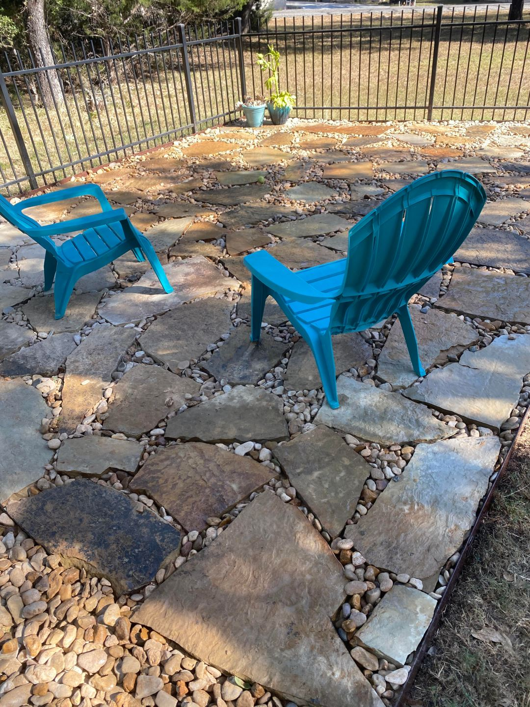 river rock and flagstone patio