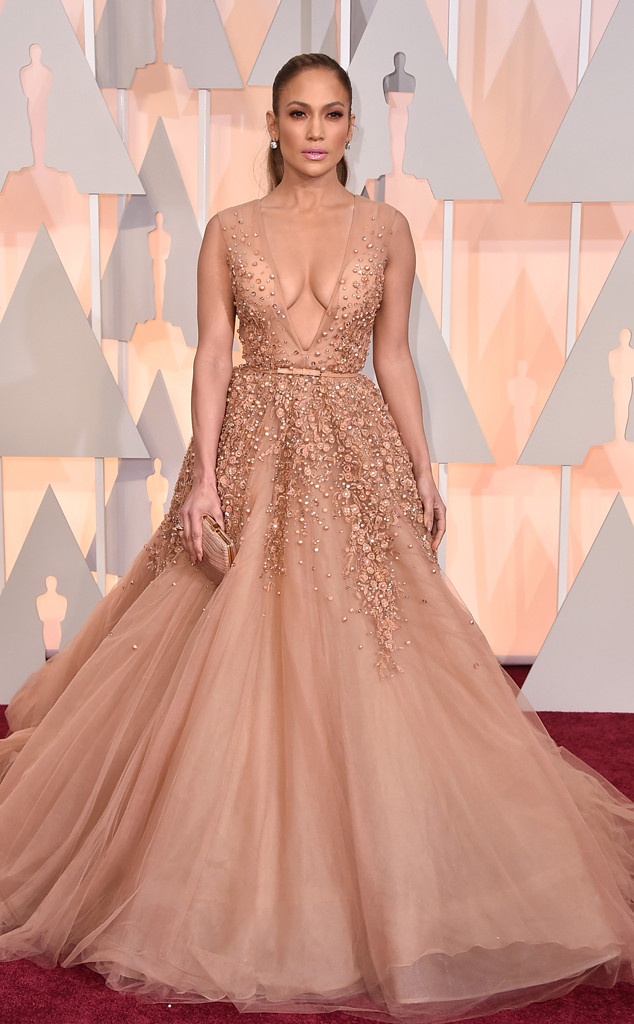j. lo at oscars same color same plunch same facial exprssion
