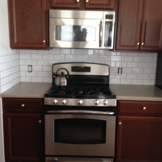 Subway tiles and stove